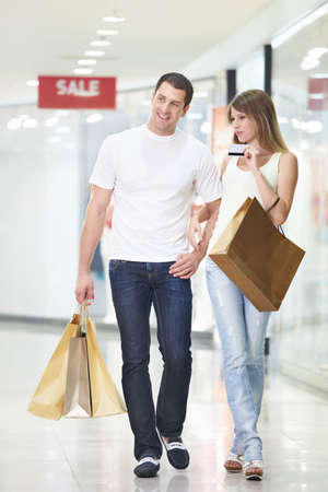 An attractive couple with a credit card at the store photo