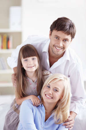 Young family with a daughter at home Stock Photo - 8096765