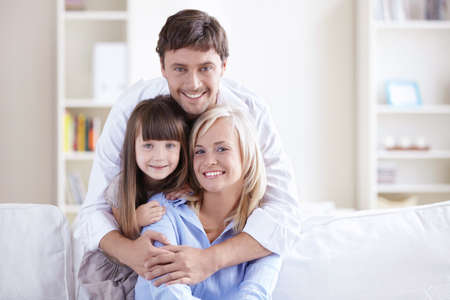 Young family with a child at home Stock Photo - 8096763