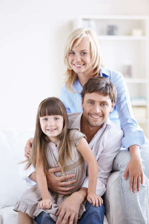Young smiling family with a child at home Stock Photo - 8096814