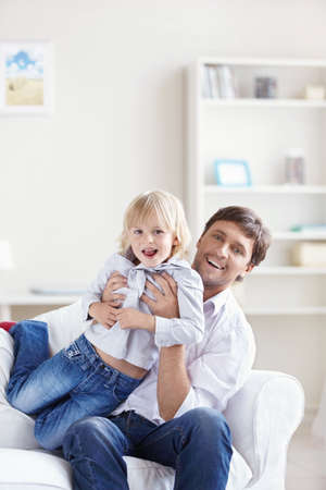 A young father with his son at home photo