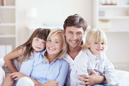 Embracing a happy family with children at home photo