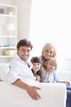 Young parents with children at home photo