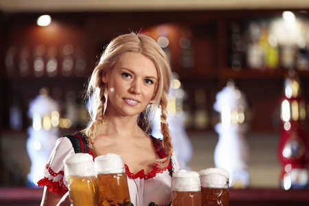 A young waitress with a beer in a pub photo