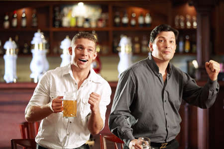 Two men are experiencing their favorite team and the pub Stock Photo - 8096783