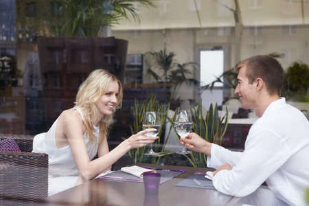 Young happy couple in love at a restaurant photo