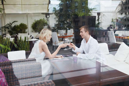 In love with a young couple in restaurant photo