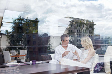 Young couple in love through the glass at a restaurant photo