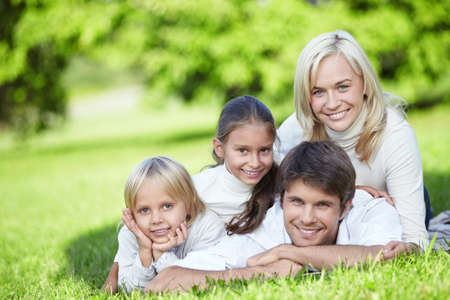 A happy family with two children outdoors photo