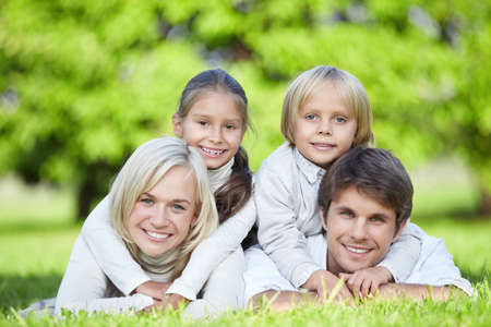 A happy family with children outdoors photo