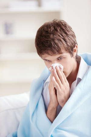 Sick man in a plaid with a handkerchief photo