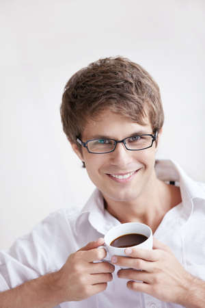 only young men: A young handsome man with a coffee