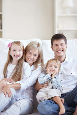 Happy young family with two children at home Stock Photo - 8096716