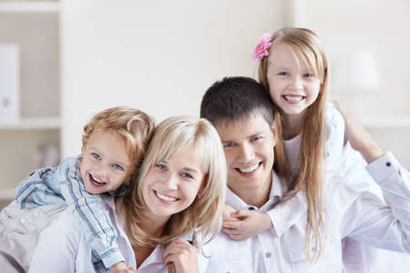 Portrait of a happy family with two children at home Stock Photo - 8096718