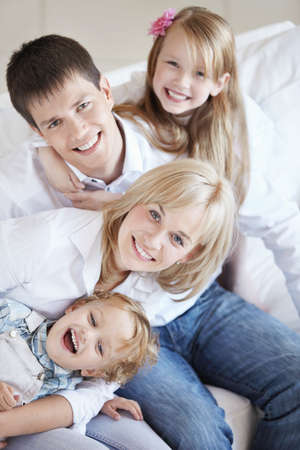 A happy family with two children on the couch Stock Photo - 8096805