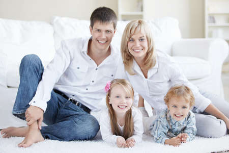 Positive family with children at home Stock Photo - 8096699