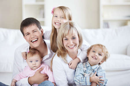 Parents and three children at home Stock Photo - 8096688