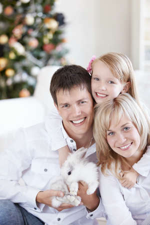 Parents with their daughter and the white rabbit photo