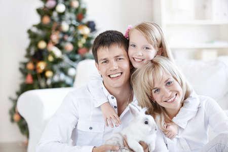 bunny xmas: A happy family with a rabbit at home