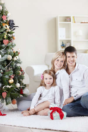 three month: Families with a child at home with decked spruce Stock Photo