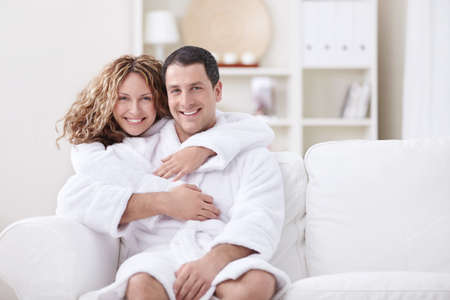dressing gowns: Young married couple in dressing gowns at home