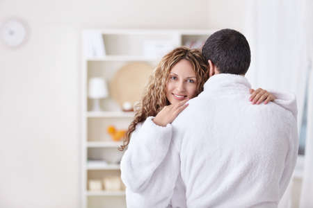 dressing gowns: Embracing a married couple in dressing gowns Stock Photo