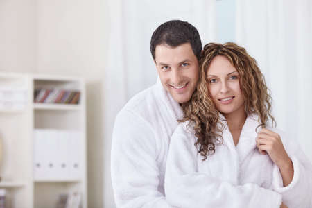 dressing gowns: A happy young couple in dressing gowns at home