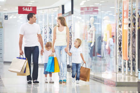 A happy family is shopping in a store photo