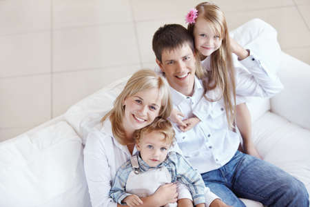 Young happy family with two children Stock Photo - 8131608