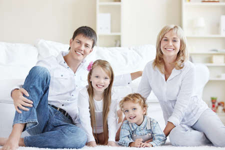 A happy family with children at home Stock Photo - 8131625