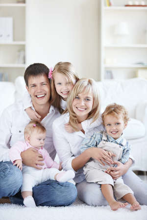 Happy parents with three children at home Stock Photo - 8131626