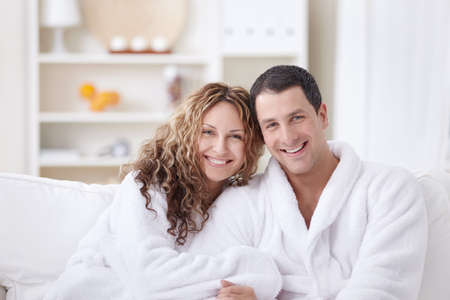 dressing gowns: Laughing attractive couple in dressing gowns
