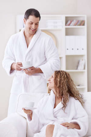 dressing gowns: Happily married couple in dressing gowns at home