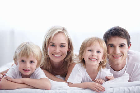 A happy family with kids in the bedroom