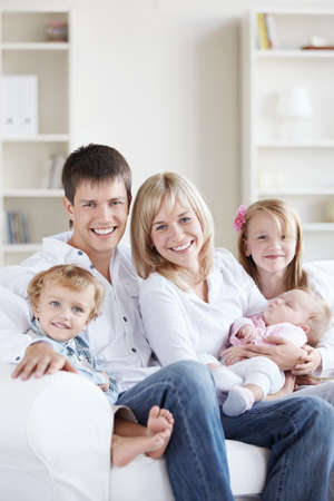 Attractive happy family with children at home Stock Photo - 8177099
