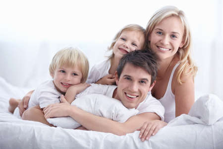 A young family with young children to bed in the bedroom Stock Photo - 8177076