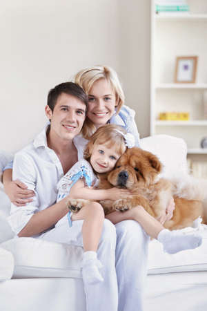 family pet: Family with pets at home Stock Photo