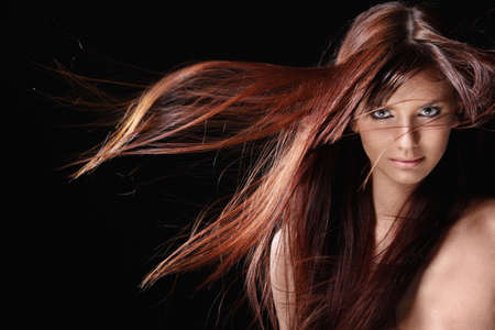 nude young: Attractive girl with red hair on a black background