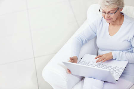 only senior women: Mature woman working with laptop Stock Photo