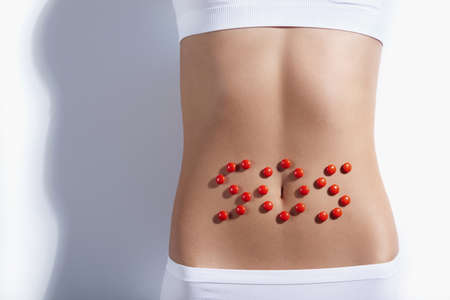 stomach: SOS sign on the stomach Stock Photo