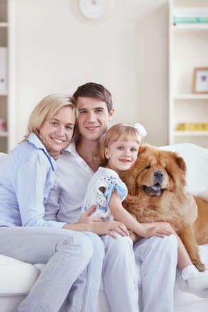 Happy family with dog at home photo