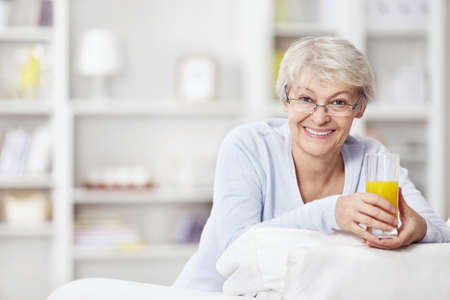 Mature attractive woman with a glass of juice