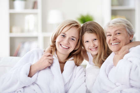 woman bathrobe: Laughing attractive family at home