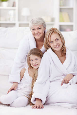 woman bathrobe: Grandmother, mother and daughter in the morning in an apartment