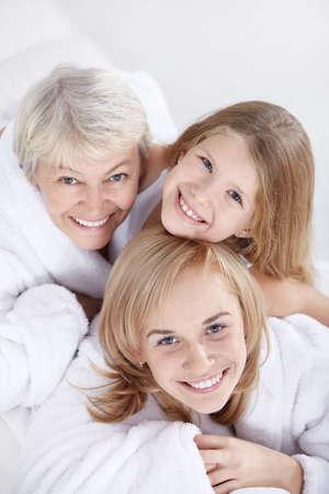 Portrait of three women on a white photo