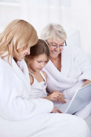 Grandmother, mother and daughter with laptop Stock Photo - 8417378