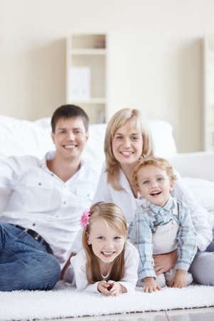 A happy family with children at home Stock Photo - 8417374