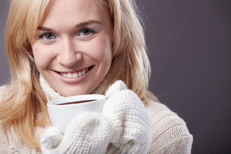 mittens: Attractive girl with a cup of mittens Stock Photo