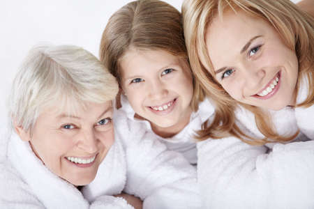 bathrobes: Portrait of a happy friendly family Stock Photo