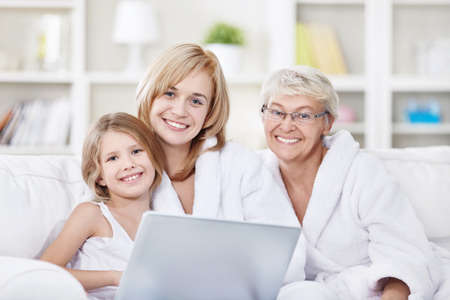 three generations of women: Portrait of three generations of women with a laptop